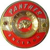 panther badge red
